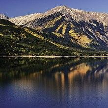 Serene Lake And Mountains